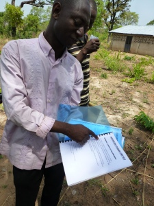 Bunyanso Farms Ltd. also offers training to farmers on farmer groups, business plans and high quality moringa, cashew and shea production. Mr. Sumani here is showing a manual that they have developed.